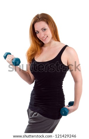 Young woman working out weight lifting dumbbells to build body strength.