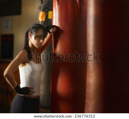 Young Woman Working out with Punching Bags - stock photo