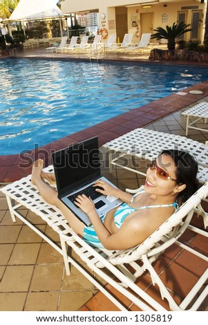 Young woman working with her laptop - stock photo