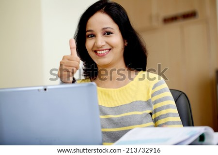 Young woman working with tablet computer at home - stock photo