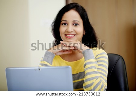 Young woman working with tablet computer at home