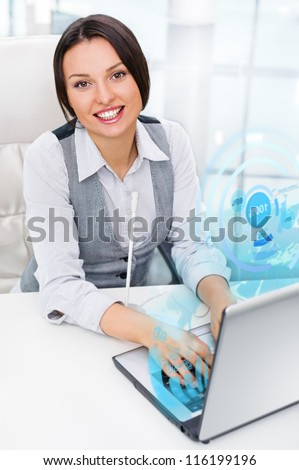 Young woman working with virtual interface - stock photo