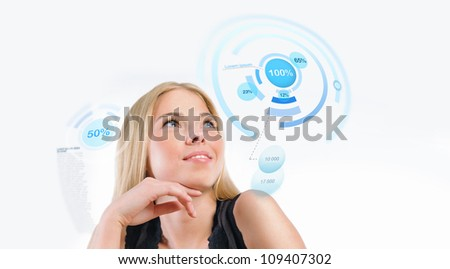 Young woman working with virtual interface against white background - stock photo