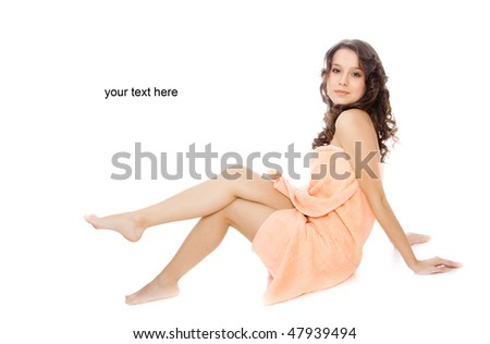 young woman wrapped in a towel - stock photo
