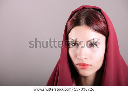 young woman wrapped in scarf - stock photo