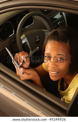 Young woman writing a check - stock photo