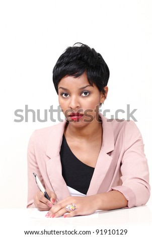 Young woman writing notes - stock photo