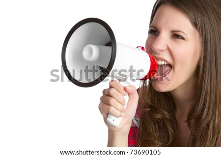 Young woman yelling into bullhorn - stock photo