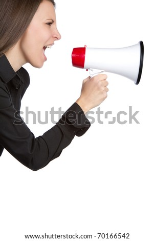 Young woman yelling into megaphone - stock photo