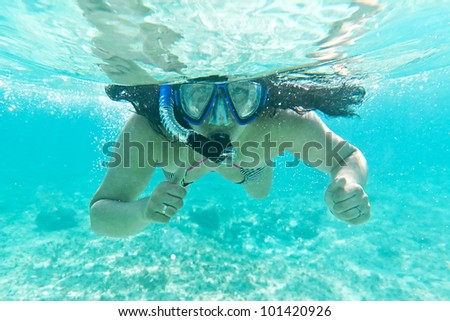 Young women at snorkeling in the Caribbean Sea - stock photo