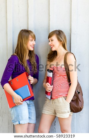 Young women carrying books - stock photo