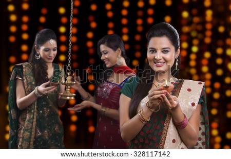Young women celebrating Diwali