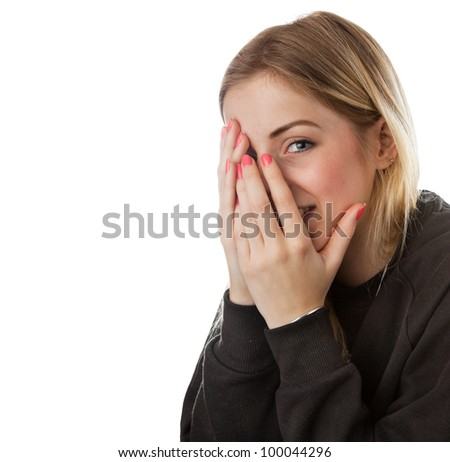 Young Women Covering Her Face and Smiling - stock photo