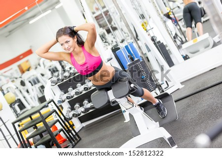 Young women do a workout at the gym - stock photo