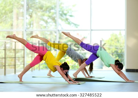 Young women do yoga in the class - stock photo