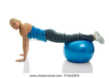 Young women doing pushups on fitness ball. Isolated on white - stock photo