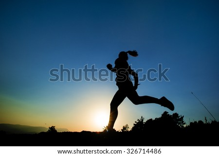 young women doing sports day at sunset