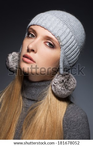Young women dressed for winter. studio shot
