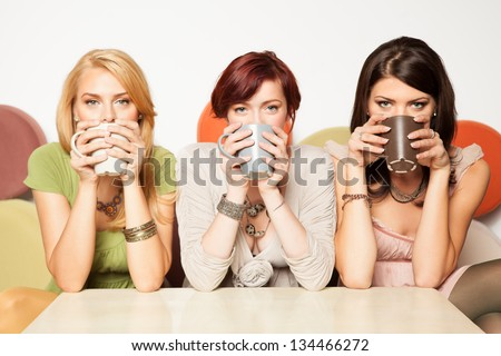 young women drinking coffee - stock photo