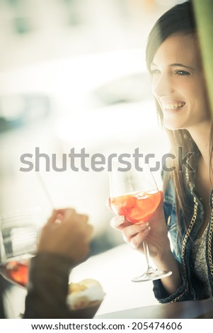 Young women enjoying their aperitif - stock photo