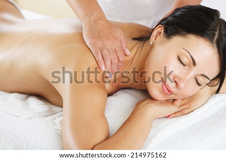 Young women having a back massage - stock photo