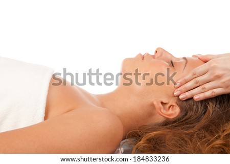 Young women having head massage at spa center