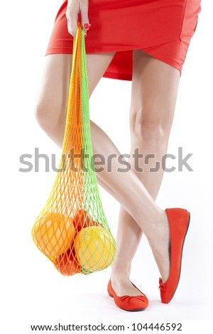 Young women holding a bag with food isolated over white background - stock photo