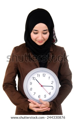 Young women holding and looking at the watch - stock photo