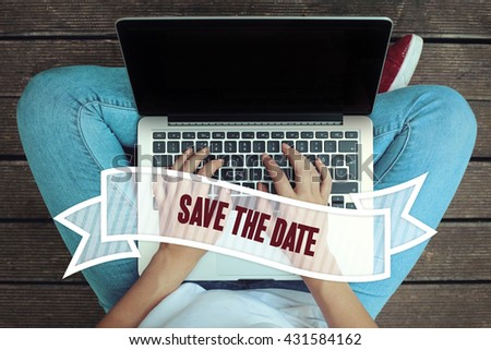 Young women holding laptop writen Save The Date  on it - stock photo