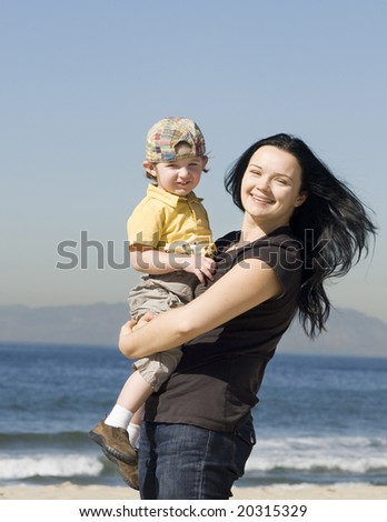 young women holding little boy and having fun - stock photo