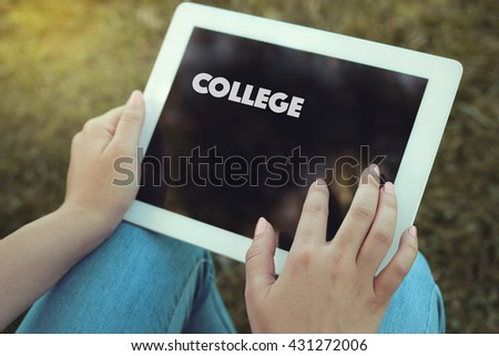 Young women holding tablet writen College on it - stock photo
