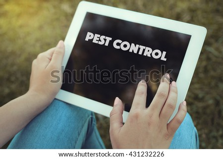 Young women holding tablet writen Pest Control on it - stock photo