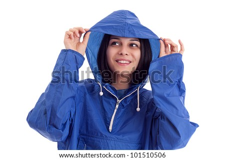 young women in a blue rain coat is looking up - stock photo