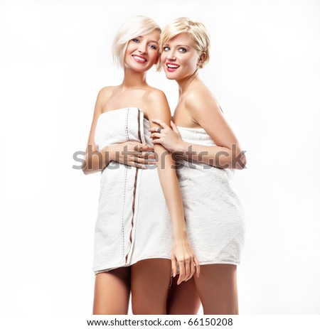 Young women in bath towels - stock photo