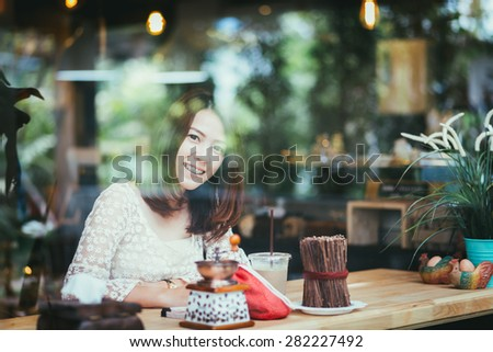 Young women in coffee shop - stock photo