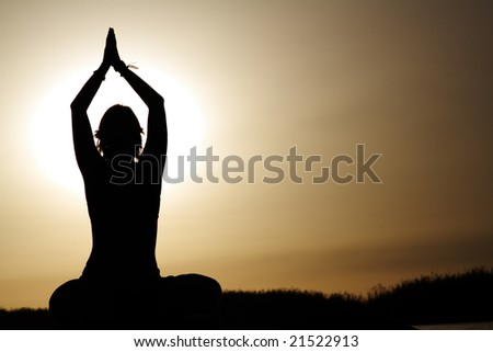 young women in lotus pose - stock photo