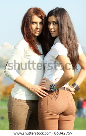 young women in park at fall outdoors - stock photo