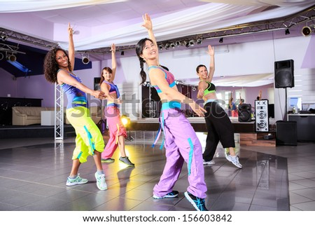 young women in sport dress at an aerobic exercise - stock photo