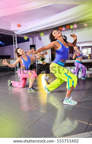 young women in sport dress at an aerobic exercise class - stock photo