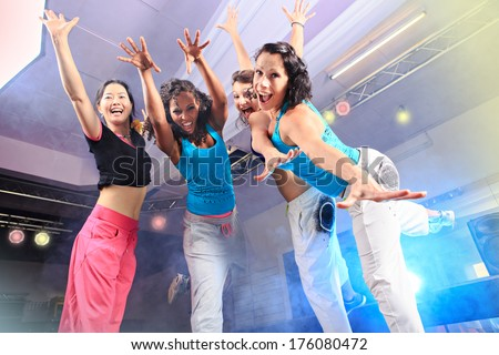 young women in sport dress jumping at an aerobic class - stock photo