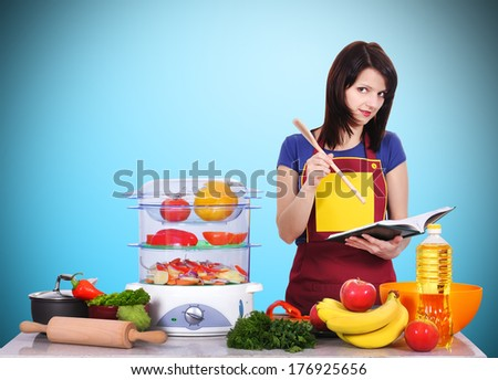 young women in the kitchen preparing dinner - stock photo