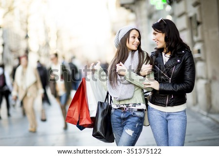 Young women in the shopping - stock photo