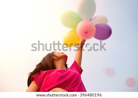 Young women joy cheerful with balloon bright sunny  - stock photo