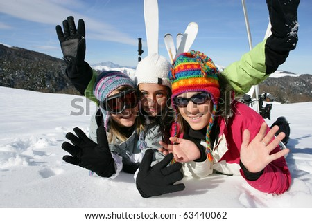 Young women laid in snow