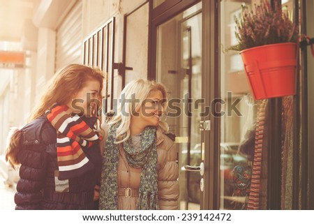 Young women looking for christmas present - stock photo