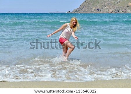 young women loves the beach and water