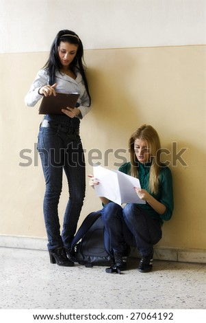 young women making notes before an exam - stock photo