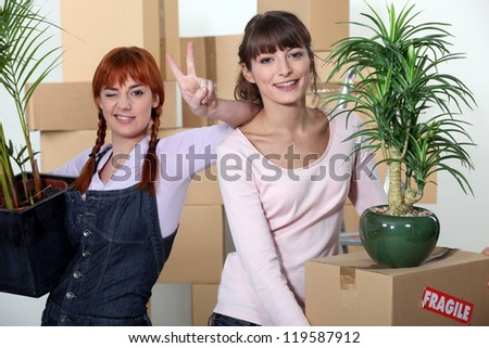 Young women moving home