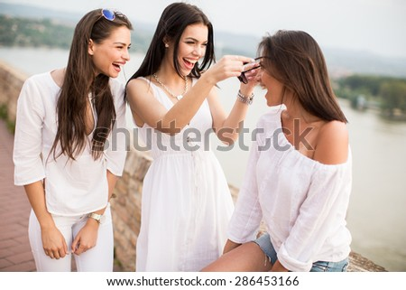 Young women on the waterfront - stock photo
