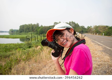 Young women photographer lifestyle on outdoor  - stock photo
